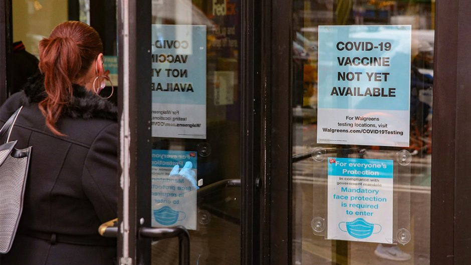 Walgreens signs remind people COVID-19 vaccine isn't ready