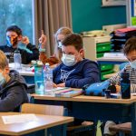 An unvaccinated teacher spread COVID-19 to 50% of students in a classroom after taking off a mask to read, CDC says